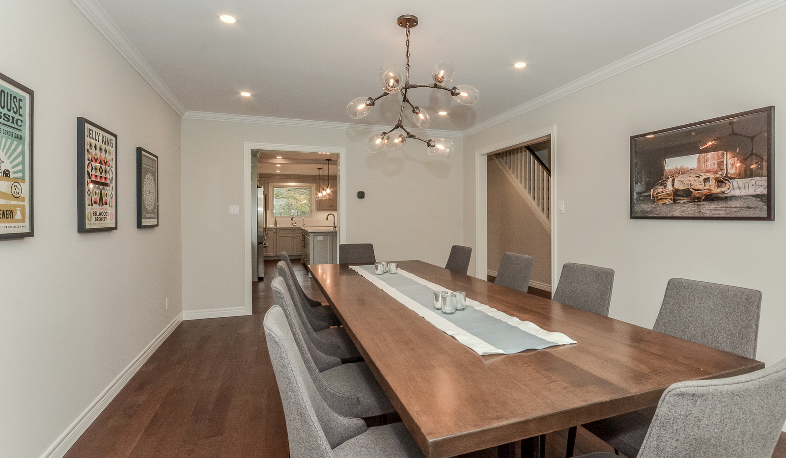 Repurposing the original living room, this large dining table has ample room for entertaining.