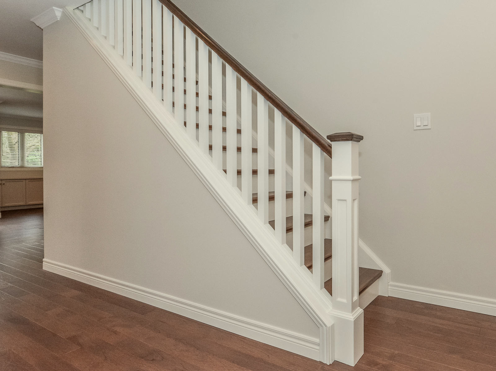 New stair treatment with square spindles, oak railing and treads.